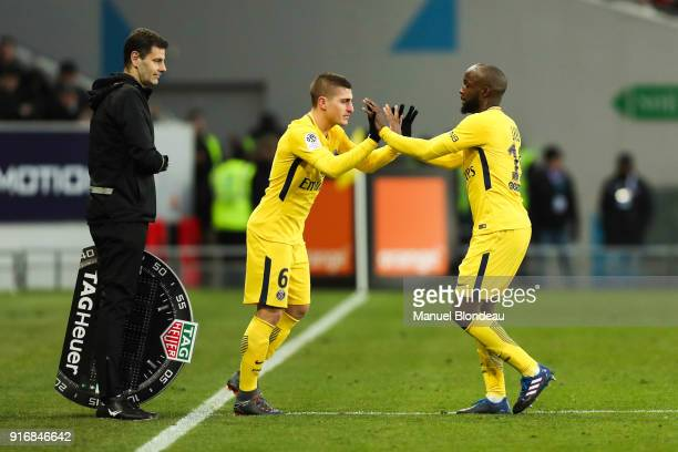 Lassana Diarra of Paris SG shakes hands with replacement Marco Verratti as he is substituted during the Ligue 1 match between Toulouse and Paris...