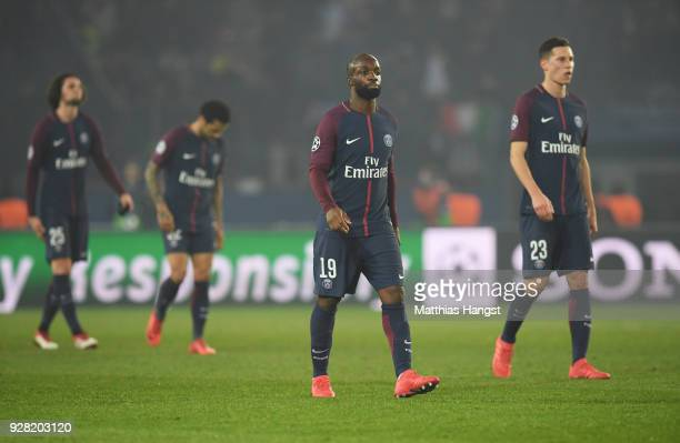 Lassana Diarra of PSG and team mates look dejected in defeat after the UEFA Champions League Round of 16 Second Leg match between Paris SaintGermain...