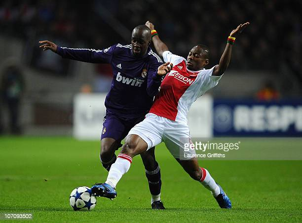 Lassana Diarra of Real Madrid battles for the ball with Eyong Enoh of Ajax during the UEFA Champions League Group G match between AFC Ajax and Real...