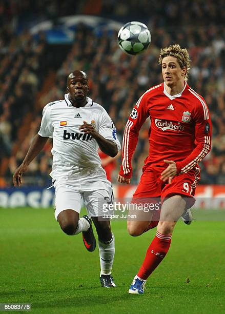 Lassana Diarra of Real Madrid chases Fernando Torres of Liverpool during the Champions League Round of 16, First Leg match between Real Madrid and...