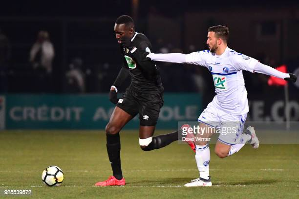 Lassana Doucoure of Chambly and Pablo Martinez of Strasbourg during the French Cup match between Chambly and Strasbourg at Stade Pierre Brisson on...