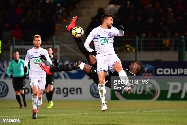 Lassana Doucoure of Chambly attempts an overhead kick under pressure from Pablo Martinez of Strasbourg during the French Cup match between Chambly...