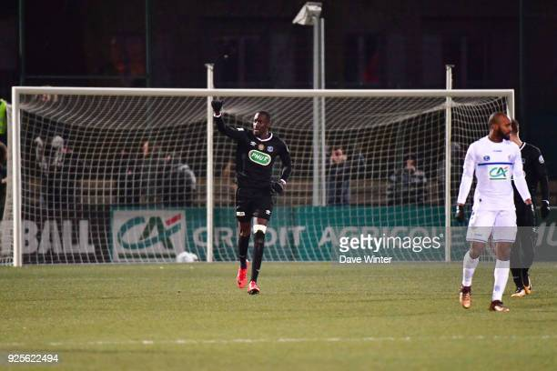 Lassana Doucoure of Chambly celebrates scoring the only goal during the French Cup match between Chambly and Strasbourg at Stade Pierre Brisson on...