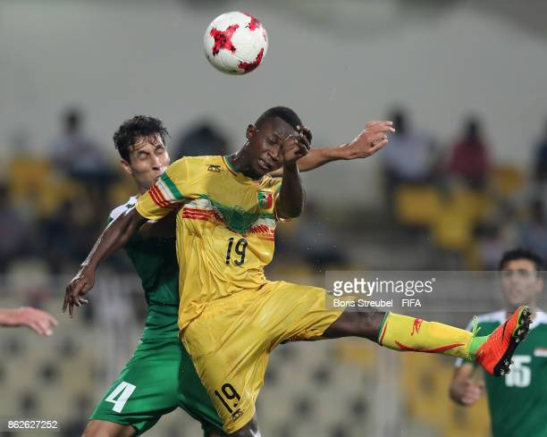 Lassana Ndiaye of Mali jumps for a header with Maytham Jabbar of Iraq during the FIFA U17 World Cup India 2017 Round of 16 match between Mali and...