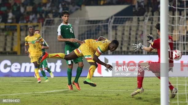 Lassana Ndiaye of Mali scores his sides second goal during the FIFA U17 World Cup India 2017 Round of 16 match between Mali and Iraq at Pandit...