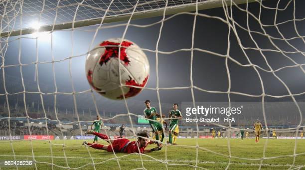 Lassana Ndiaye of Mali scores his team's fourth goal against goalkeeper Ali Ibadi of Iraq during the FIFA U17 World Cup India 2017 Round of 16 match...