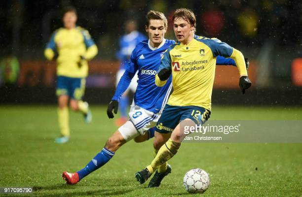 Lasse Fosgaard of Lyngby BK and Simon Tibbling of Brondby IF compete for the ball during the Danish Alka Superliga match between Lyngby BK and...