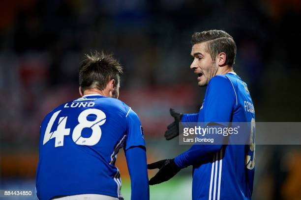 Lasse Fosgaard speaks to Oliver Lund of Lyngby BK during the Danish Alka Superliga match between Lyngby BK and AaB Aalborg at Lyngby Stadion on...