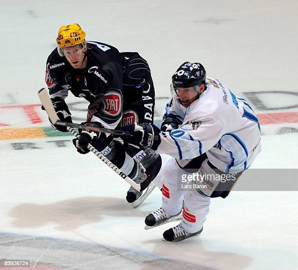 Lasse Kopitz of Frankfurt challenges Jason Dunham of Straubing during the DEL match between Frankfurt Lions and Straubing Tigers at the Eissporthalle...