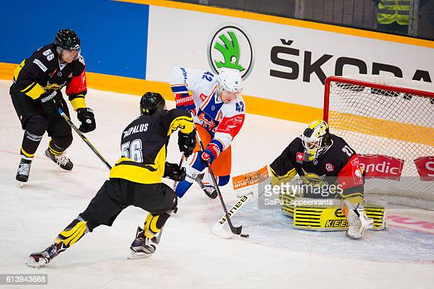 Lasse Lappalainen , Lauri Taipalus and Jussi Markkanen of Lappeenranta challenges Otto Rauhala of Tampere during the Champions Hockey League Round of...