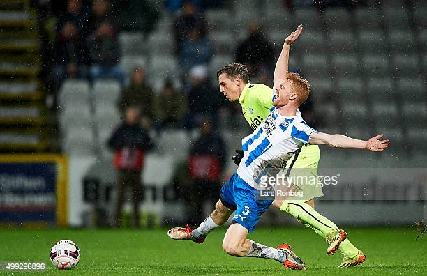 Lasse Nielsen of OB Odense and Nicki Bille Nielsen of Esbjerg fB compete for the ball during the Danish Alka Superliga match between OB Odense and...
