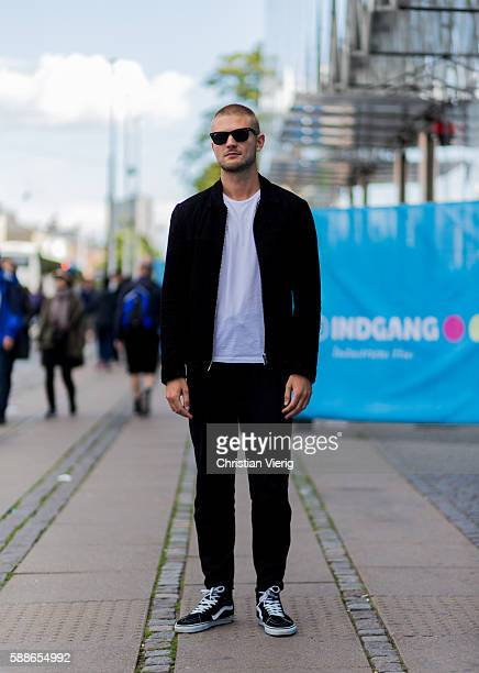 Lasse Rasmussen wearing a black jacket and black jogger pants Vans shoes and white tshirt outside Revolver Fair during the second day of the...