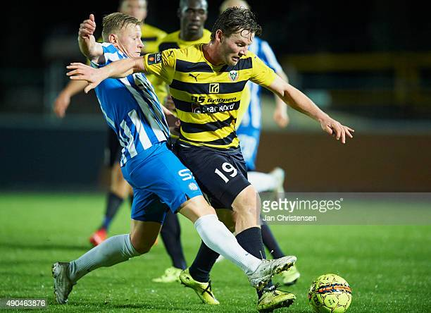 Lasse Rise of Esbjerg fB and Pal Alexander Kirkevold of Hobro IK compete for the ball during the Danish Alka Superliga match between Hobro IK and...