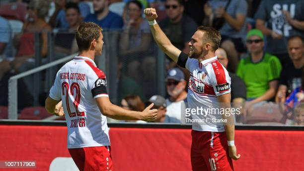 Lasse Schlueter and Fabio Viteritti of Cottbus celebrate during the 3. Liga match between FC Energie Cottbus and F.C. Hansa Rostock at Stadion der...