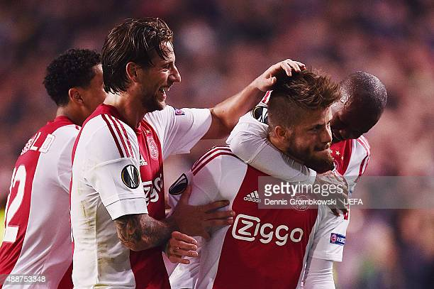 Lasse Schoene of AFC Ajax celebrates with team mates as he scores the equalizing goal during the UEFA Europa League Group A match between AFC Ajax...