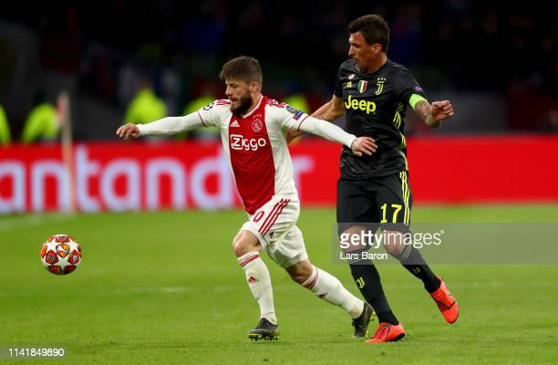 Lasse Schoene of Amsterdam is challenged by Mario Mandzukic of Juventus during the UEFA Champions League Quarter Final first leg match between Ajax...