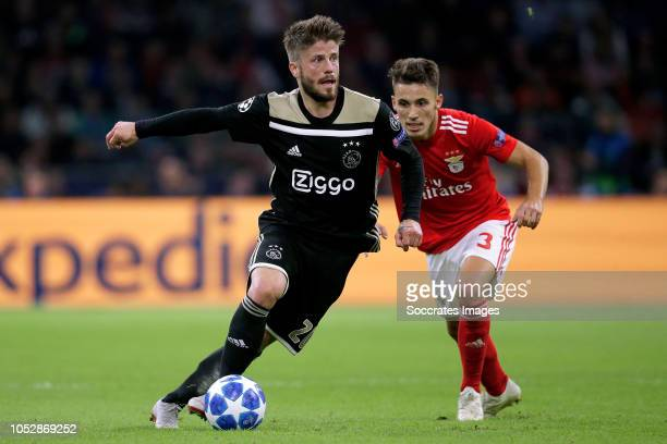 Lasse Schone of Ajax Alex Grimaldo of Benfica during the UEFA Champions League match between Ajax v Benfica at the Johan Cruijff Arena on October 23...