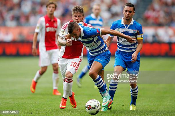 Lasse Schone of Ajax and Jesper Drost of Zwolle battle for the ball during the 19th Johan Cruijff Shield match between Ajax Amsterdam and PEC Zwolle...