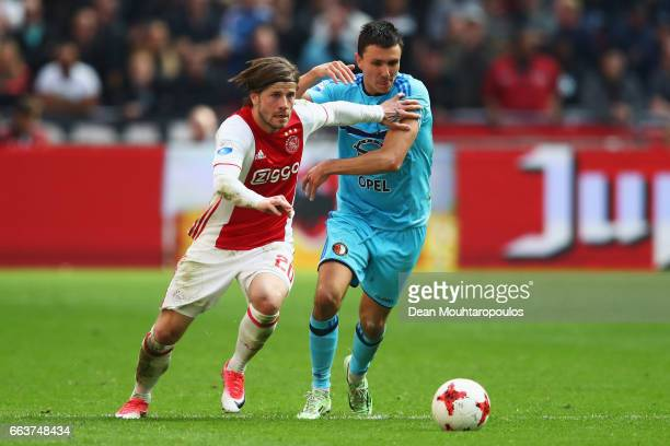 Lasse Schone of Ajax battles for the ball with Steven Berghuis of Feyenoord Rotterdam during the Dutch Eredivisie match between Ajax Amsterdam and...