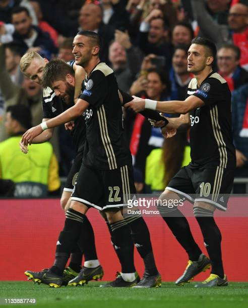 Lasse Schone of Ajax celebrates after scoring his team's fourth goal with team mates during the UEFA Champions League Round of 16 Second Leg match...