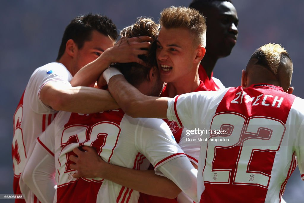 Lasse Schone of Ajax celebrates scoring his teams first goal of the game with team mates Nick Viergever, Daley Sinkgraven, Davinson Sanchez and Hakim Ziyech during the Dutch Eredivisie match between Ajax Amsterdam and Feyenoord at Amsterdam ArenA on April 2, 2017 in Amsterdam, Netherlands.