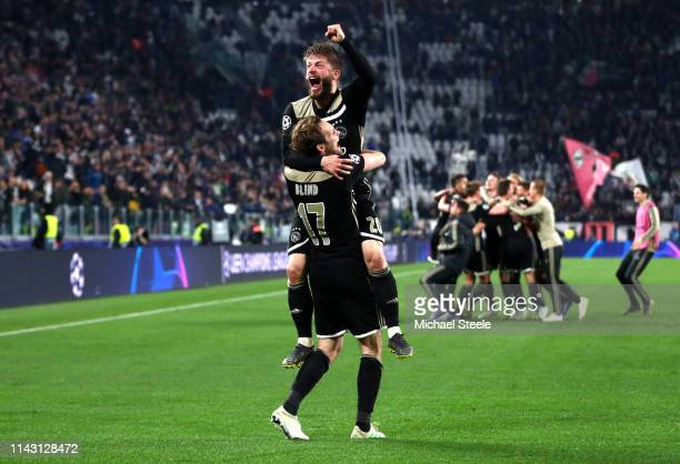 Lasse Schone of Ajax celebrates victory with Daley Blind of Ajax during the UEFA Champions League Quarter Final second leg match between Juventus and...