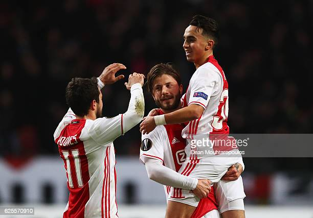 Lasse Schone of Ajax celebrates with Amin Younes and Abdelhak Nouri as he scores their first goal during the UEFA Europa League Group G match between...