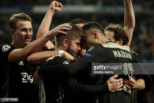 Lasse Schone of Ajax celebrates with his teammates after scoring team's fourth goal during UEFA Champions League Round of 16 second leg match between...