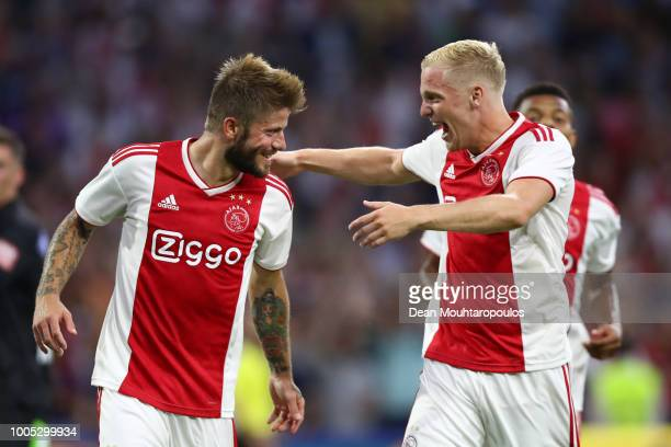 Lasse Schone of Ajax celebrates with team mate Donny van de Breek after scoring his team's second goal during the first leg UEFA Champions League...