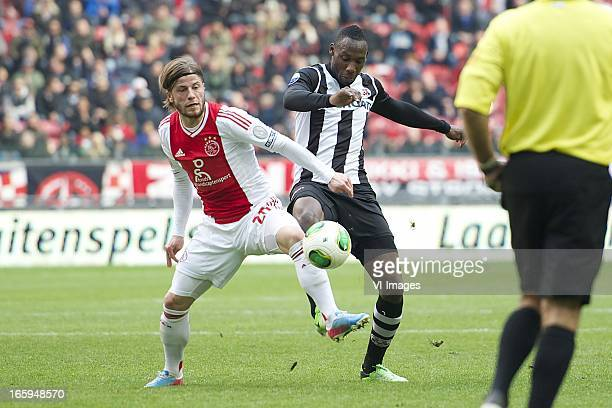 Lasse Schone of Ajax Geoffrey Castillion of Heracles Almelo during the Dutch Eredivisie match between Ajax Amsterdam and Heracles Almelo at the...