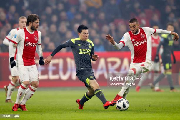 Lasse Schone of Ajax Hirving Lozano of PSV Hakim Ziyech of Ajax during the Dutch Eredivisie match between Ajax v PSV at the Johan Cruijff Arena on...