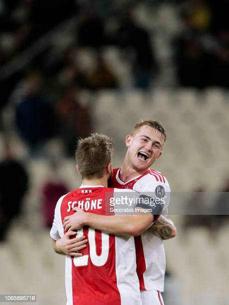 Lasse Schone of Ajax Matthijs de Ligt of Ajax celebrates the victory during the UEFA Champions League match between AEK Athene v Ajax at the...