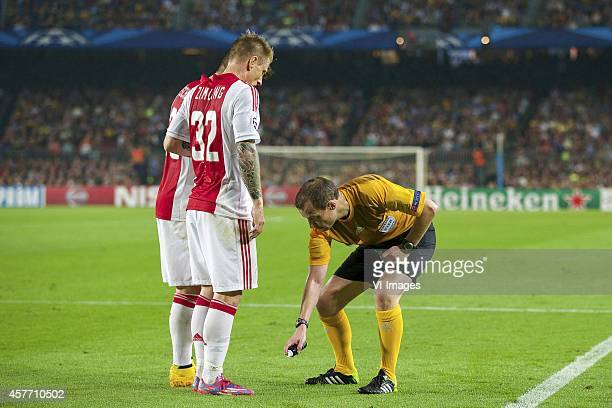 Lasse Schone of Ajax, Niki Zimling of Ajax, referee William Collum spray during the group F Champions League match between Barcelona and Ajax...