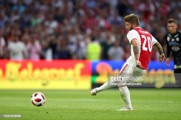 Lasse Schone of Ajax scores his team's second goal during the first leg UEFA Champions League Qualifier match between Ajax and SK Sturm Graz at...