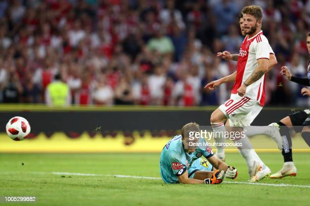 Lasse Schone of Ajax scores his team's second goal past Jörg Siebenhandl of SK Sturm Graz during the first leg UEFA Champions League Qualifier match...
