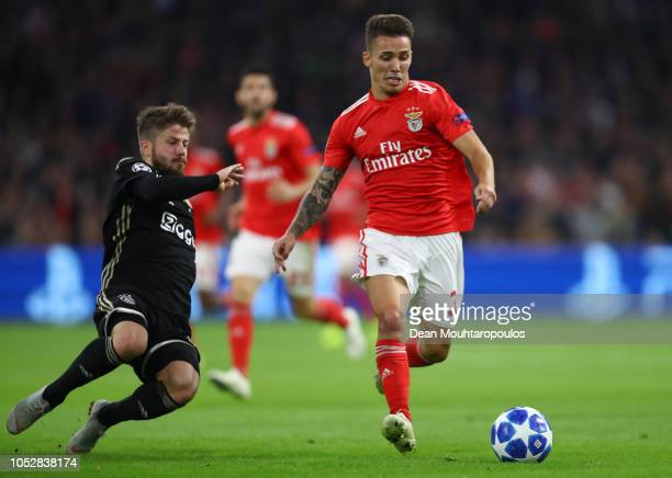 Lasse Schone of Ajax tackles Alex Grimaldo of Benfica during the Group E match of the UEFA Champions League between Ajax and SL Benfica at Johan...
