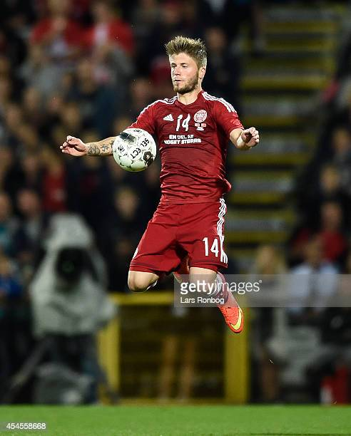 Lasse Schone of Denmark controls the ball during the international friendly between Denmark and Turkey at TreFor Park on September 3 2014 in Odense...