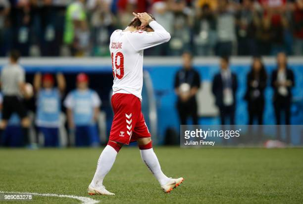 Lasse Schone of Denmark looks dejected after missing his teams first penalty during a penalty shoot out during the 2018 FIFA World Cup Russia Round...