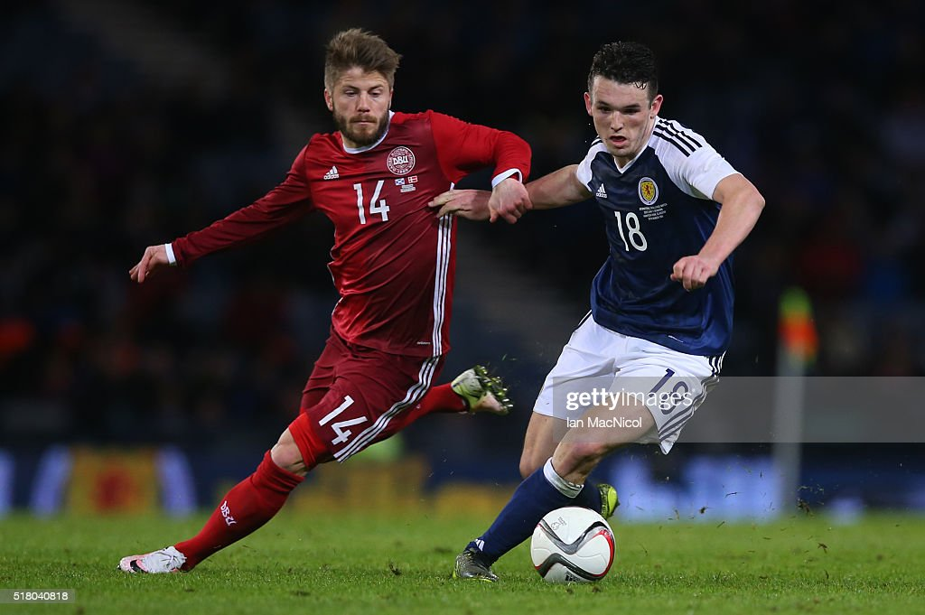 Lasse Schone of Denmark vies with John McGinn of Scotland during the International Friendly match between Scotland and Denmark at Hampden Park on March 29, 2016 in Glasgow, Scotland.