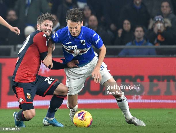 Lasse Schone of Genoa CFC battle for the ball with Albin Ekdal of UC Sampdoria during the Serie A match between Genoa CFC and UC Sampdoria at Stadio...