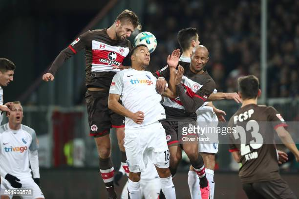 LR Lasse Sobiech and Christopher Avevor of Pauli and Jan Gyamerah of Bochum compete for the ball during the Second Bundesliga match between FC St...