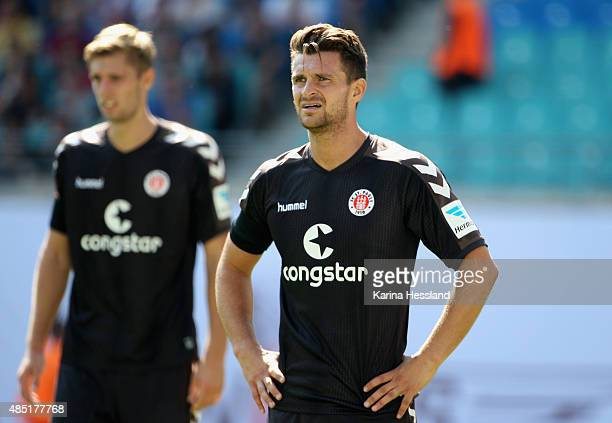 Lasse Sobiech and Enis Alushi of St Pauli during the Second League match between RB Leipzig and FC StPauli at RedBull Arena on August 23 2015 in...