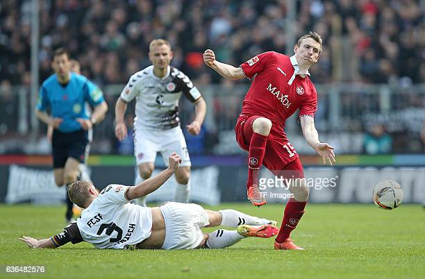 Lasse Sobiech of FC St Pauli and Jon Dadi Boedvarsson of Kaiserslautern battle for the ball during the Second Bundesliga match between FC St Pauli...