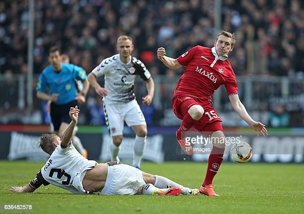 Lasse Sobiech of FC St Pauli and Jon Dadi Boedvarsson of Kaiserslautern battle for the ball during the Second Bundesliga match between FC St Pauli...