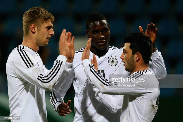 Lasse Sobiech of Germany celebrates the first goal with Peniel Mlapa and Tolgay Arslan during the U21 International Friendly match between Germany...