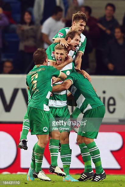 Lasse Sobiech of Greuther Fuerth celebrates his team's third goal with team mates during the Bundesliga match between 1899 Hoffenheim and SpVgg...