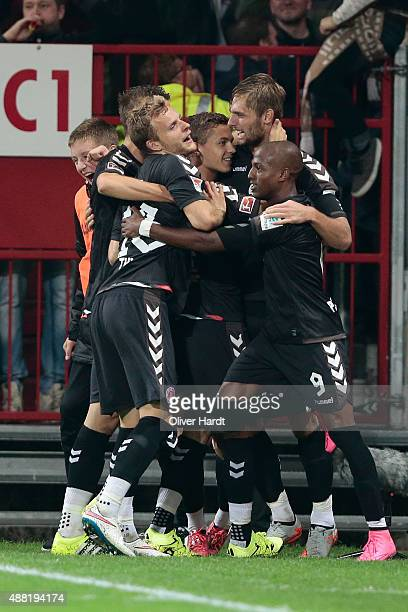 Lasse Sobiech of Pauli acelebrates with his team mates after scoring their first goal during the Second Bundesliga match between FC St Pauli and MSV...