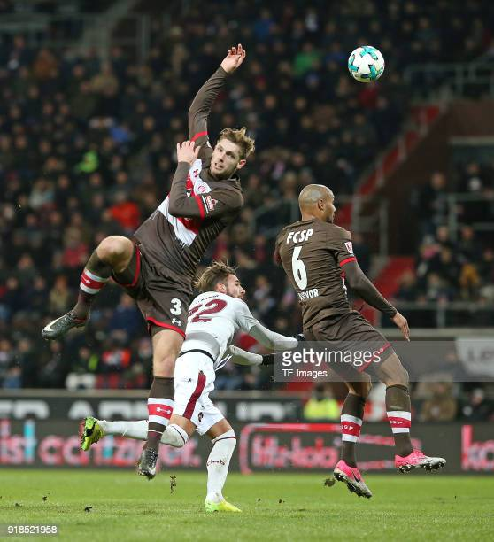 Lasse Sobiech of St Pauli and Enrico Valentini of Nuernberg and Christopher Avevor of St Pauli battle for the ball during the Second Bundesliga match...