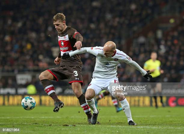 Lasse Sobiech of St Pauli and Tobias Werner of Nuernberg battle for the ball during the Second Bundesliga match between FC St Pauli and 1 FC...