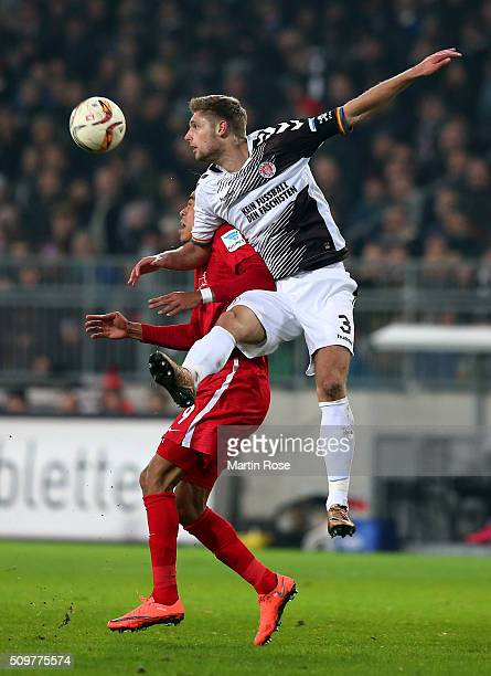 Lasse Sobiech of St Pauli challenges for the ball with Yussuf Poulsen of Leipzig during the second Bundesliga match between FC St Pauli and RB...